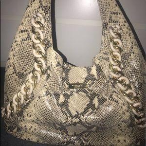 MK Python chain ID bag.